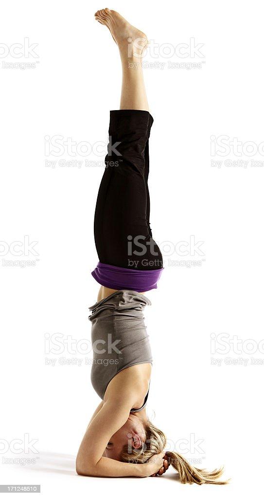 Young woman demostrating Salamba Sirsasana or supported headstand stock photo