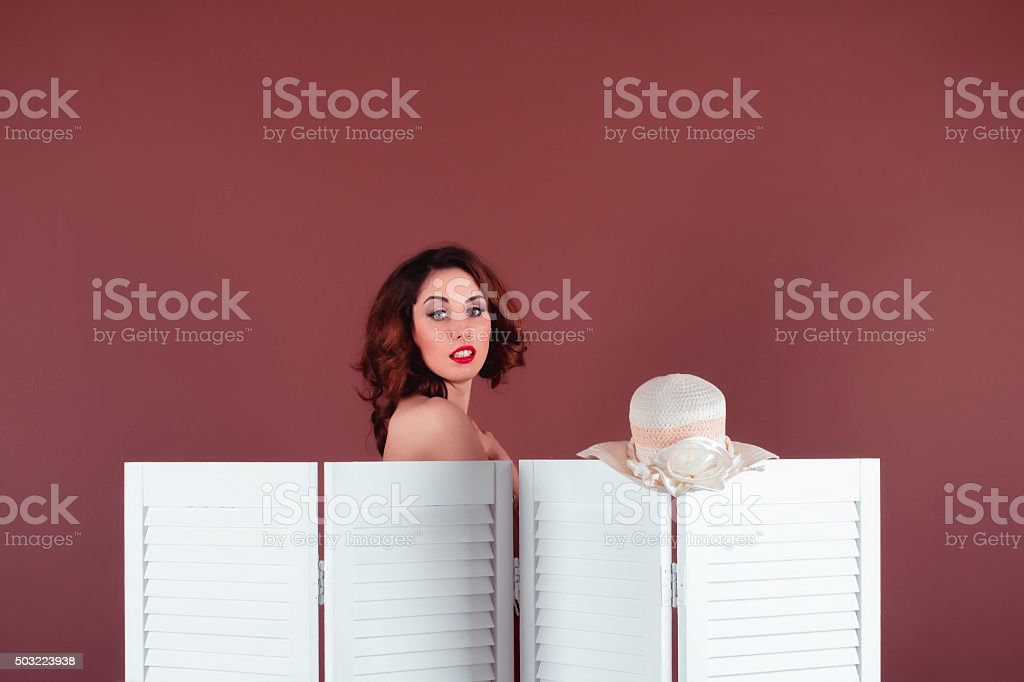 Young woman disguised behind a screen stock photo