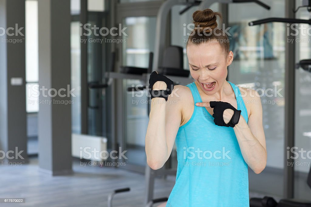 Young woman disturbed by the armpit fat stock photo