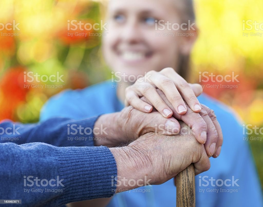 Young woman doctor helping a senior stock photo