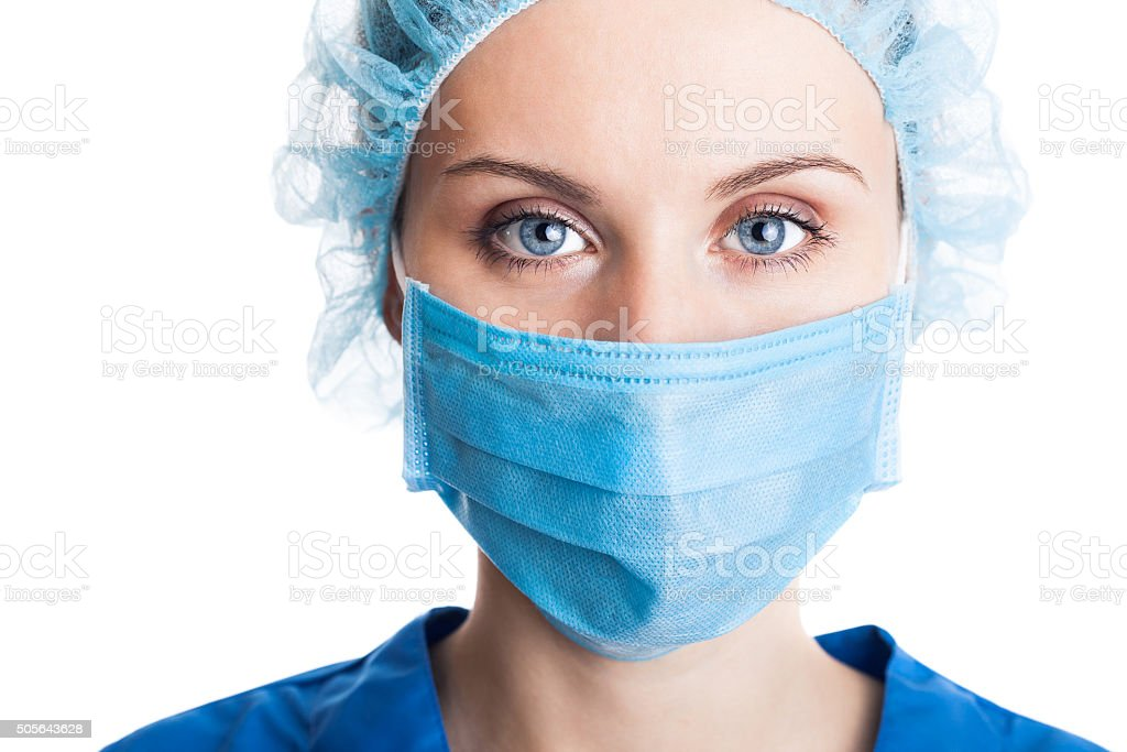 Young woman doctor in cap and face mask stock photo