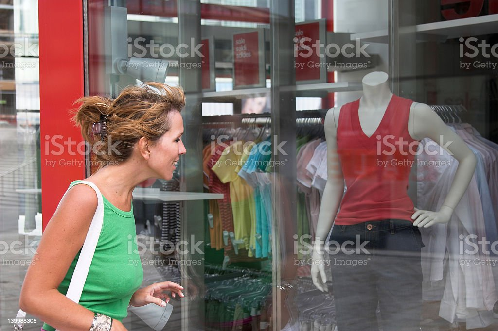 Young woman does some window shopping stock photo