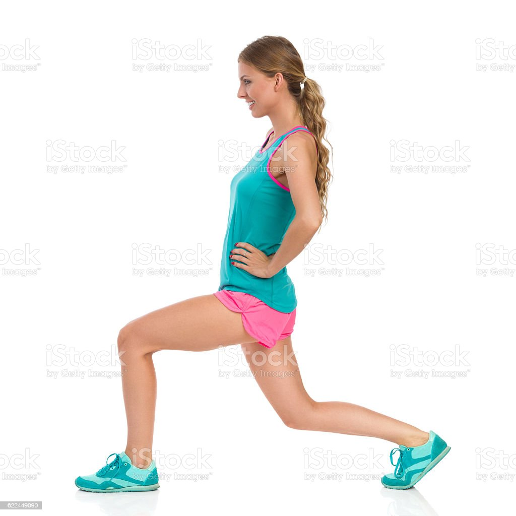 Young Woman Does Split Squat. Side View stock photo