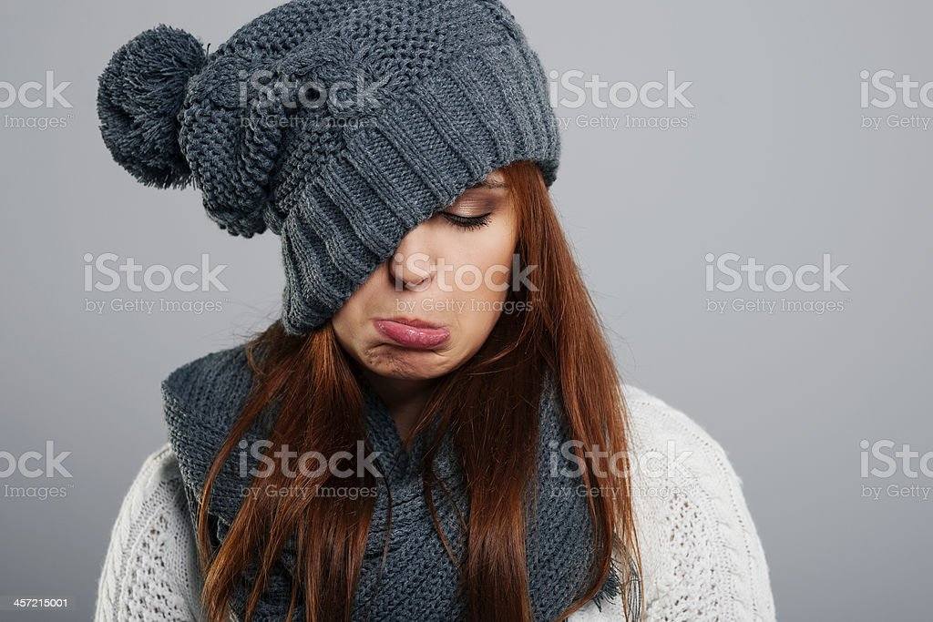 Young woman doesn't like winter time stock photo
