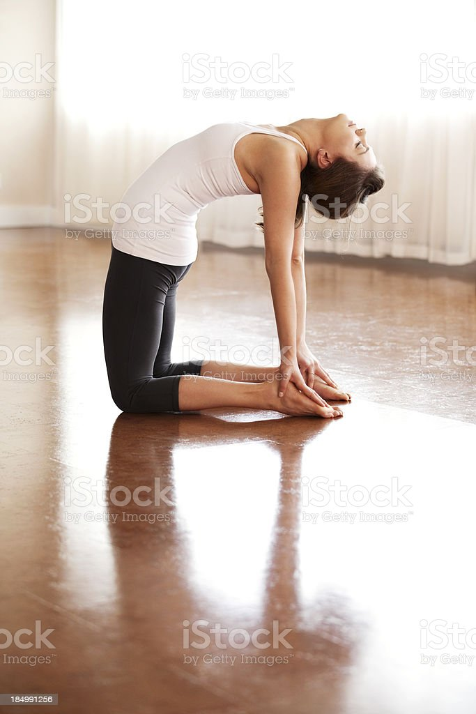 Young woman doing a yoga backbend stock photo