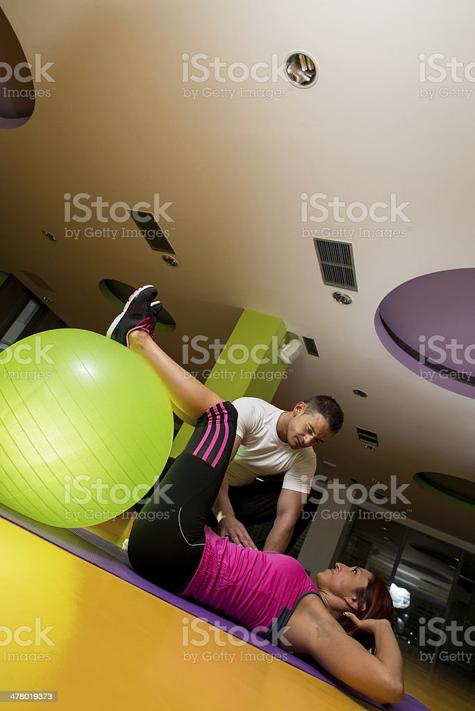 Young Woman Doing Crunches in a gym royalty-free stock photo