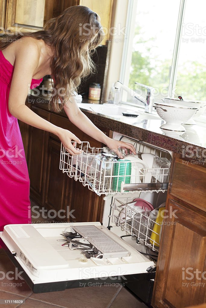 Young Woman Doing Dishes stock photo