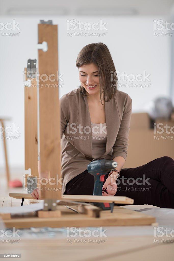 Young woman doing DIY repairs at home stock photo