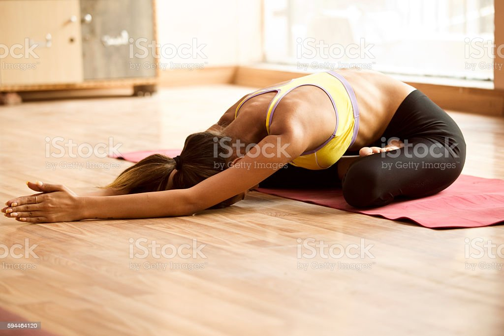 Young woman doing exercise stock photo