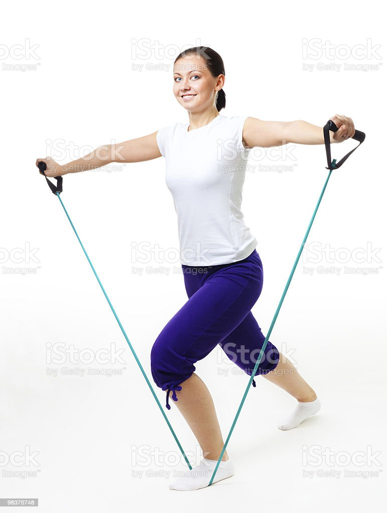 Young woman doing fitness with expander stock photo
