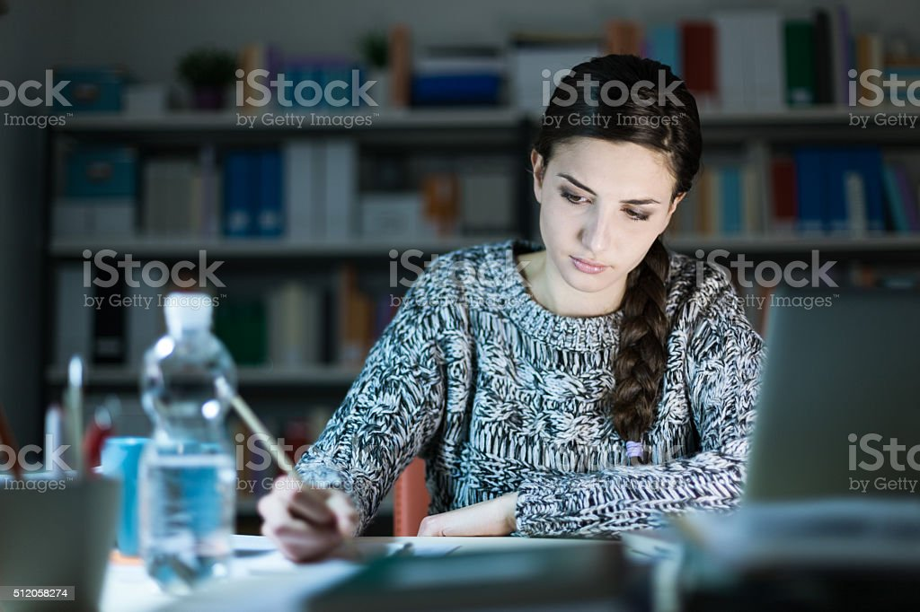 Young woman doing homework stock photo