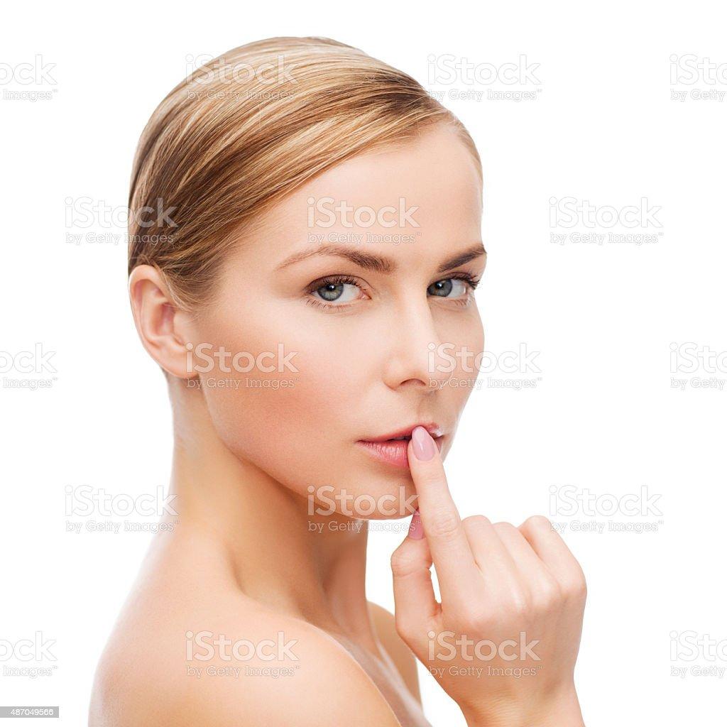 young woman doing hush gesrute stock photo