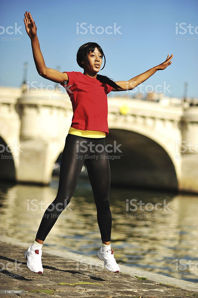 Young Woman Doing Jumping Jacks stock photo