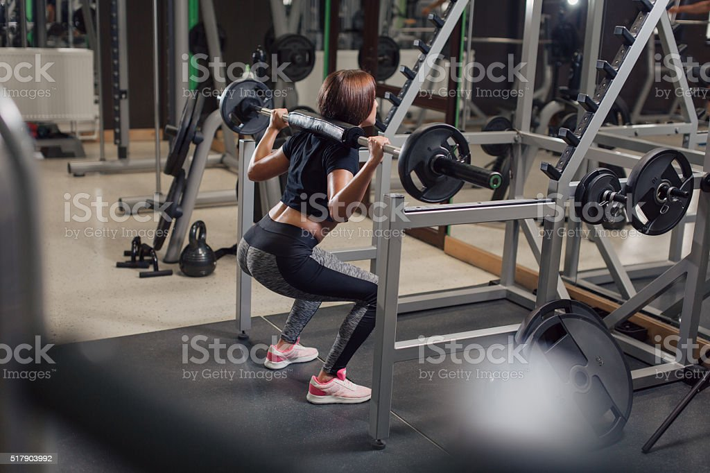 Young woman doing legs exercises at the gym stock photo