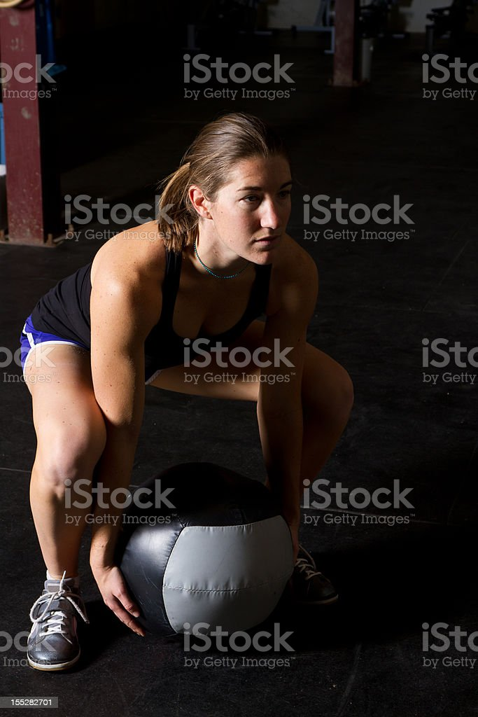 Young Woman doing Med Ball Clean royalty-free stock photo