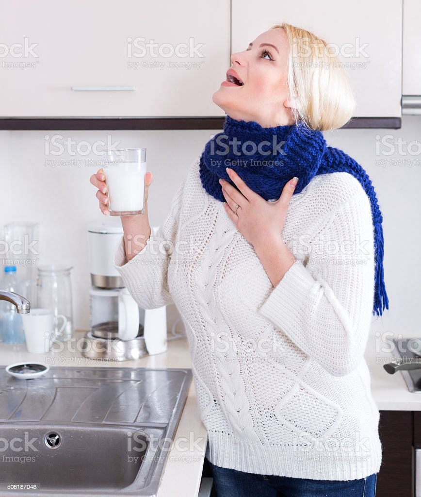Young woman doing oral rinsing stock photo