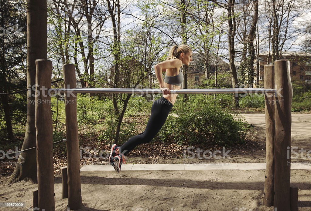 Young woman doing parallel bar dips stock photo