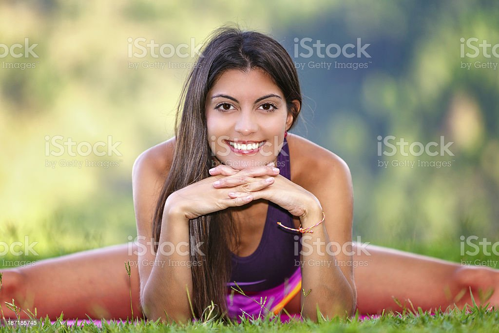 Young woman doing pilates outdoors in nature royalty-free stock photo
