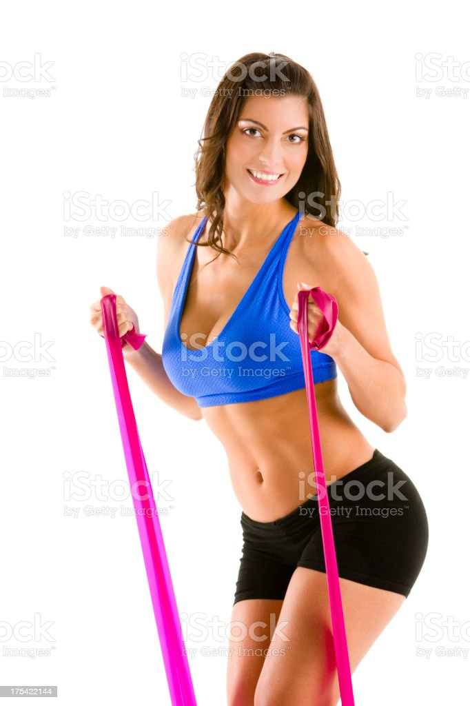 Young woman doing Pilates with slings during workout royalty-free stock photo