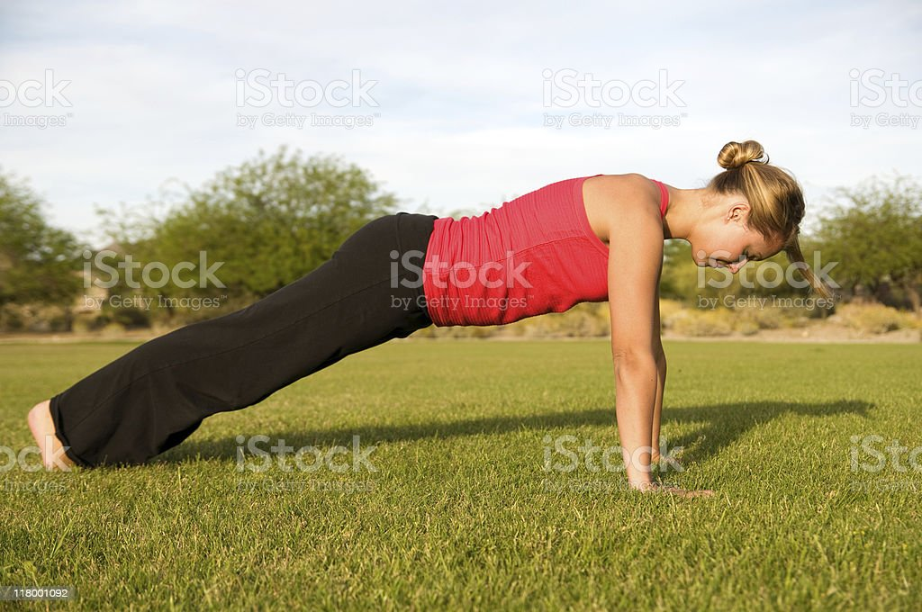 Young woman doing push up. stock photo
