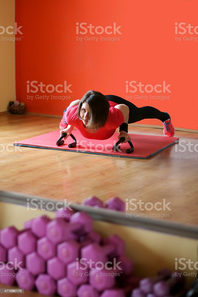 Young woman doing push ups stock photo