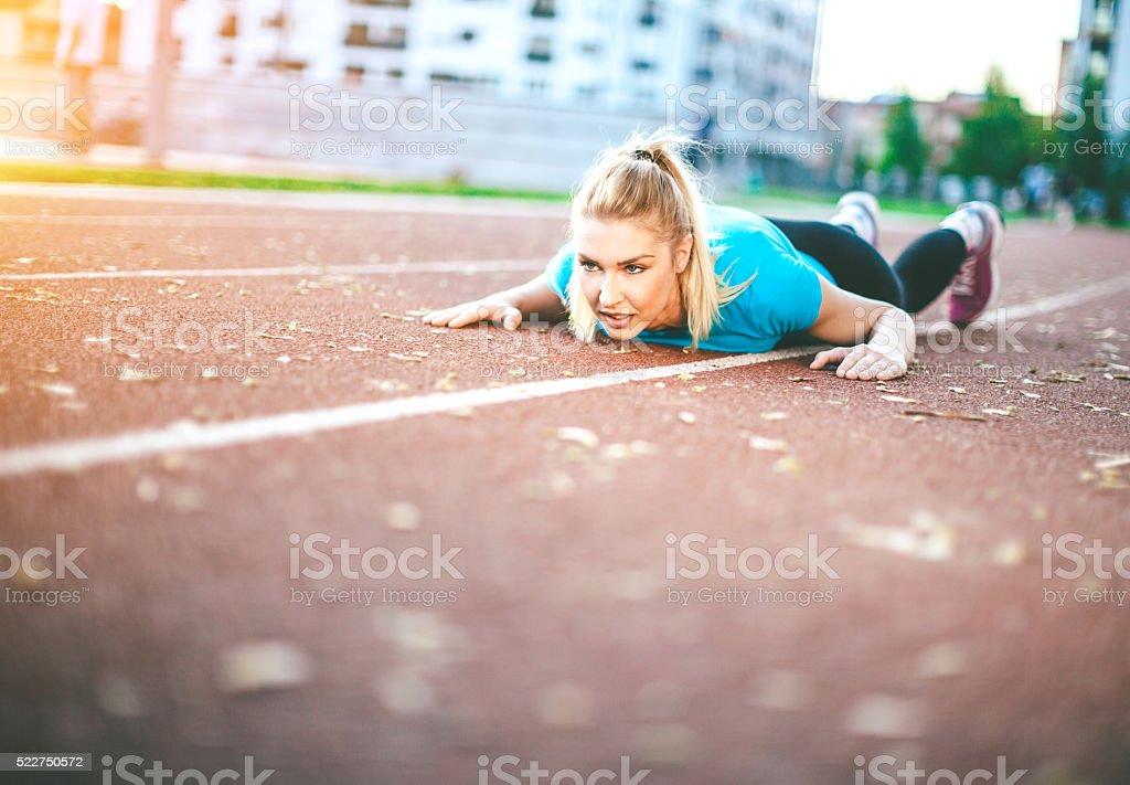 young woman doing push-ups stock photo