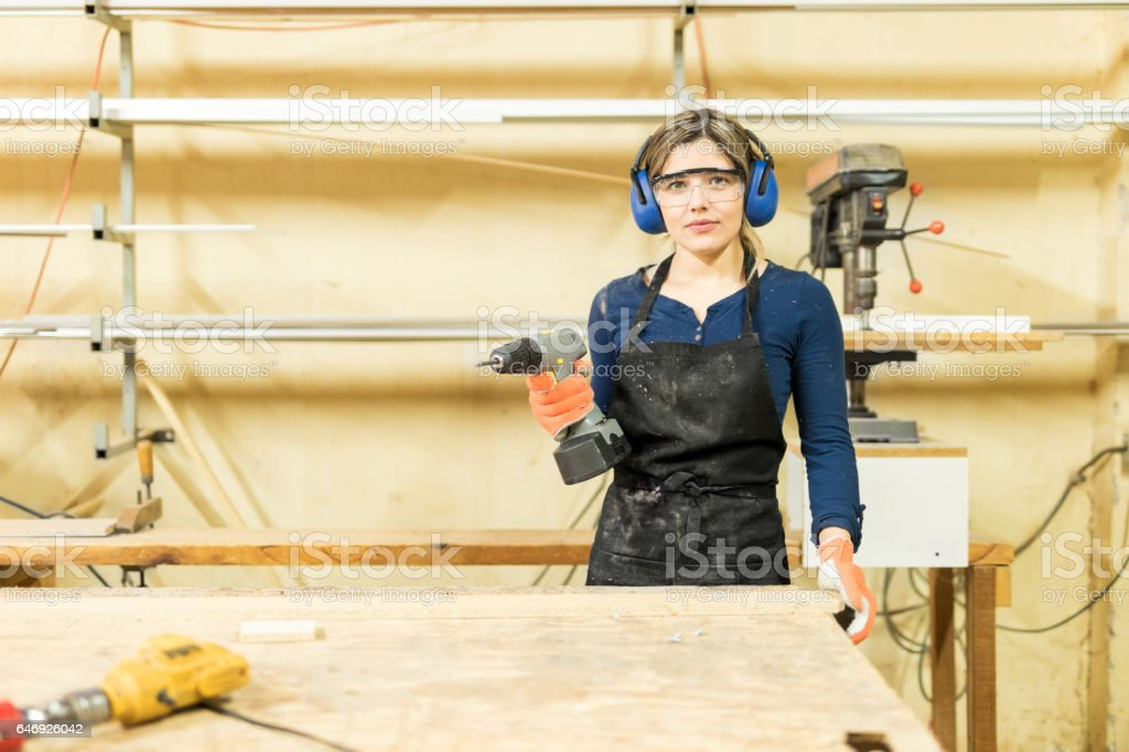 Young woman doing some woodwork stock photo