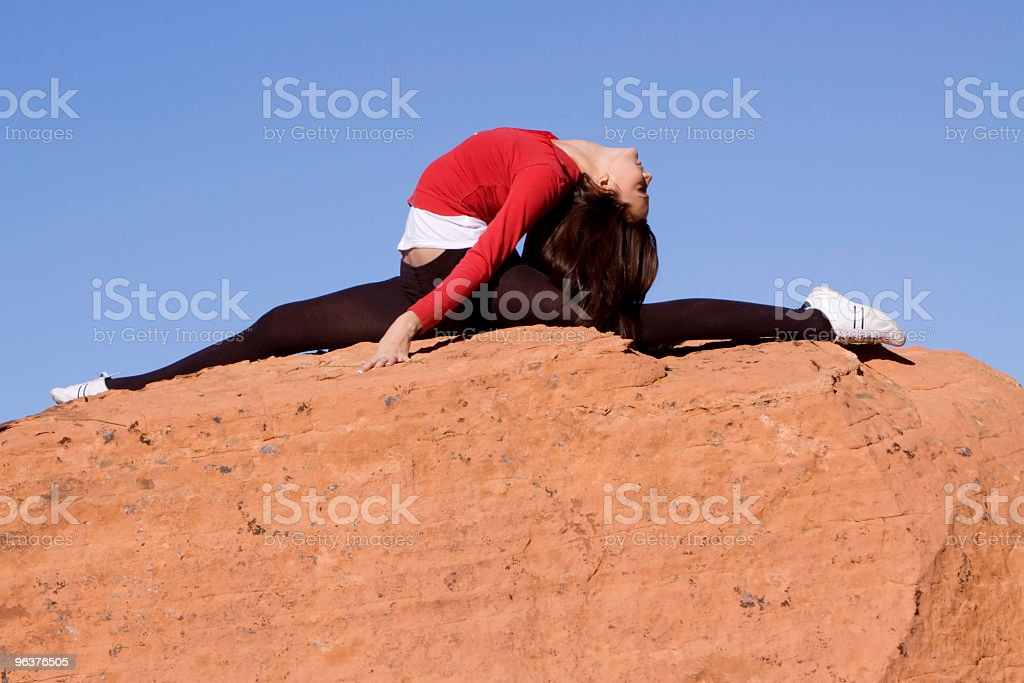 Young woman doing split stock photo