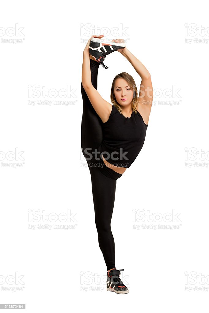 Young woman doing standing split isolated stock photo