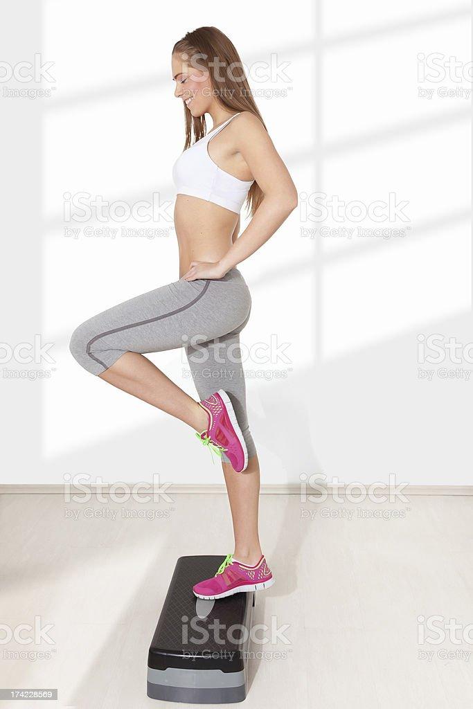 Young woman doing step aerobics stock photo