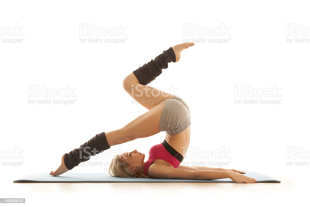 Young woman doing stretching exercise at home stock photo