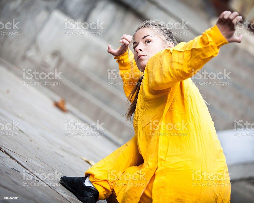 Young woman doing Tai Chi stock photo