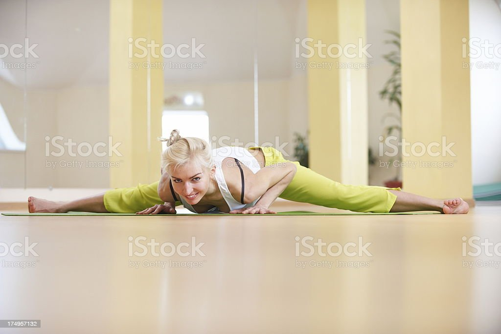 young woman doing upavishtha konasana royalty-free stock photo