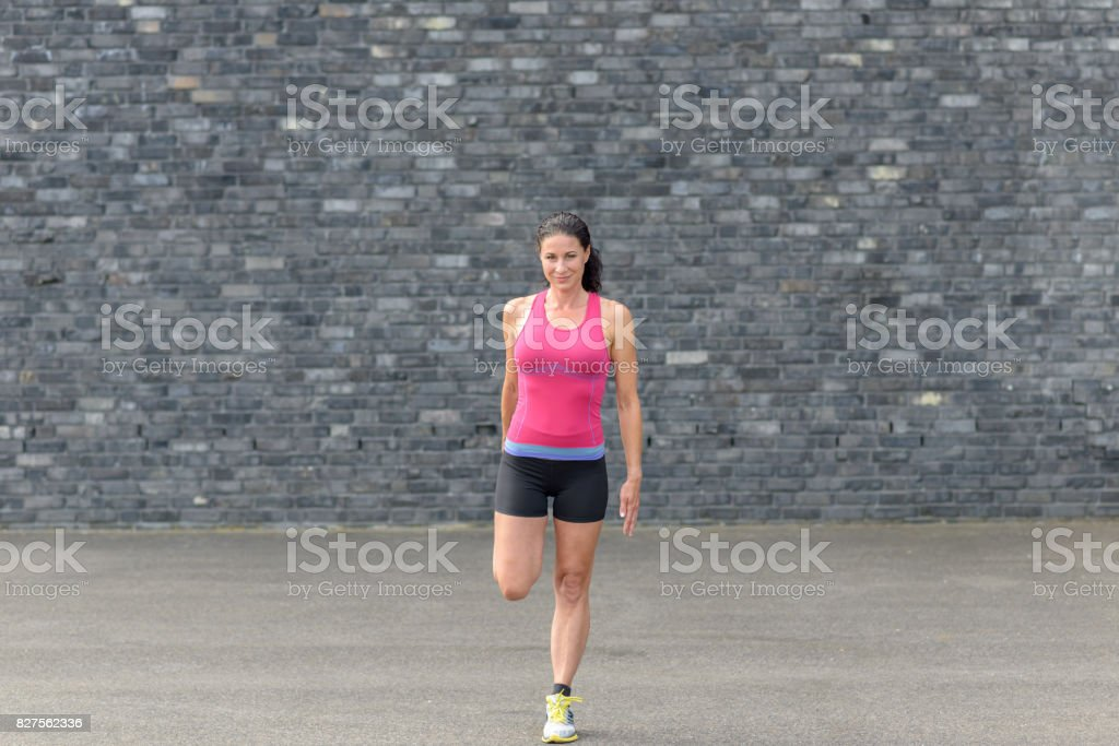 Young woman doing warming up exercises stock photo