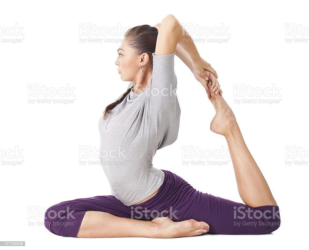 Young woman doing yoga asana one legged king pigeon royalty-free stock photo