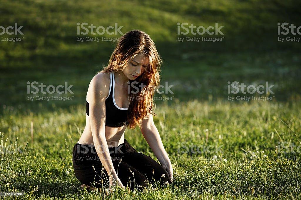 Young woman doing yoga asana royalty-free stock photo