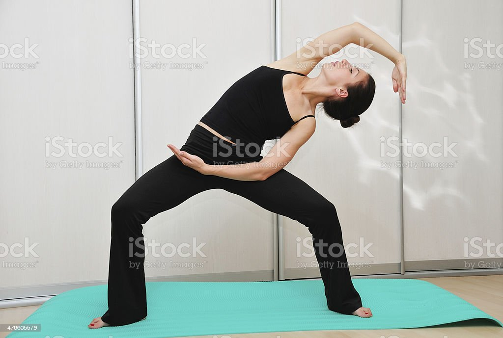Young woman doing yoga asana royalty-free stock photo