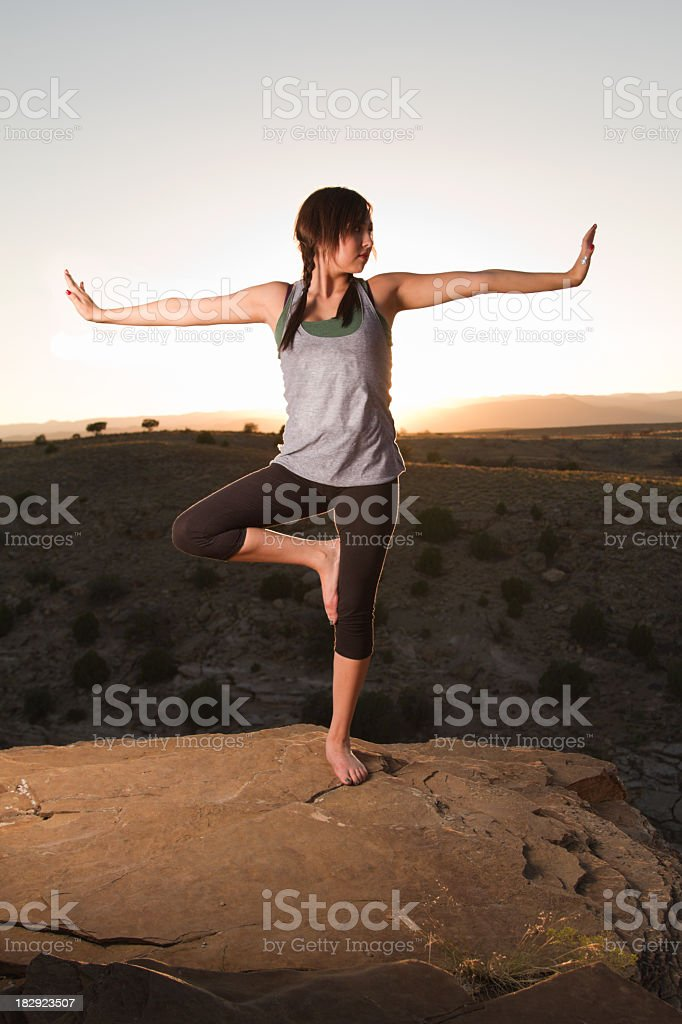 Young Woman Doing Yoga at Sunset royalty-free stock photo