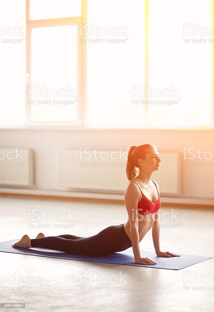 Young woman doing yoga cobra pose stock photo