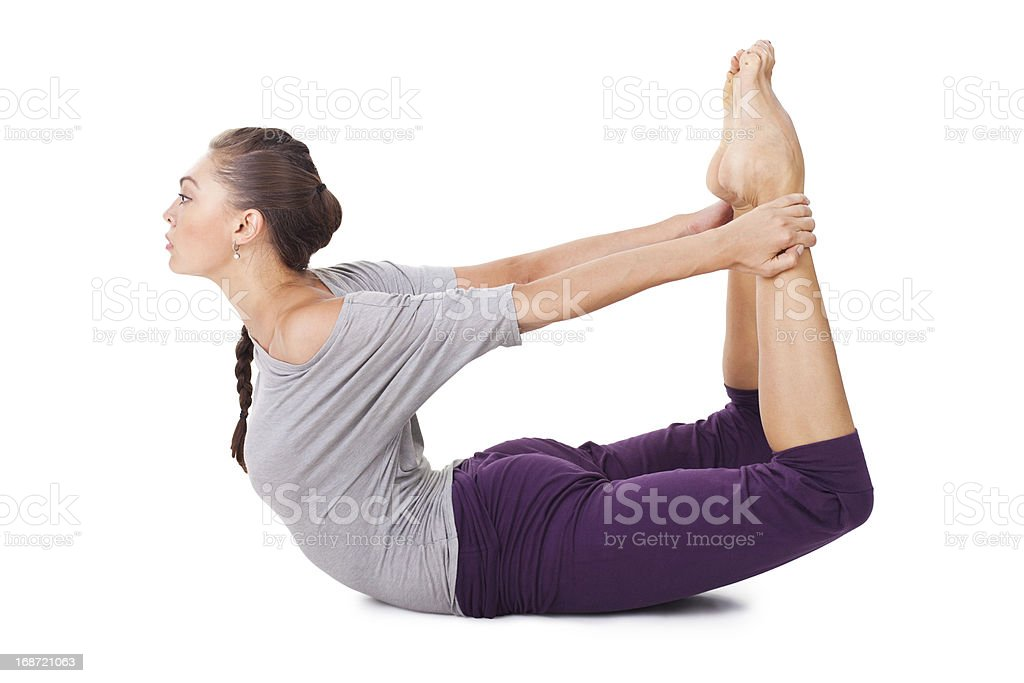 Young woman doing yoga exercise Dhanurasana (Bow Pose) royalty-free stock photo