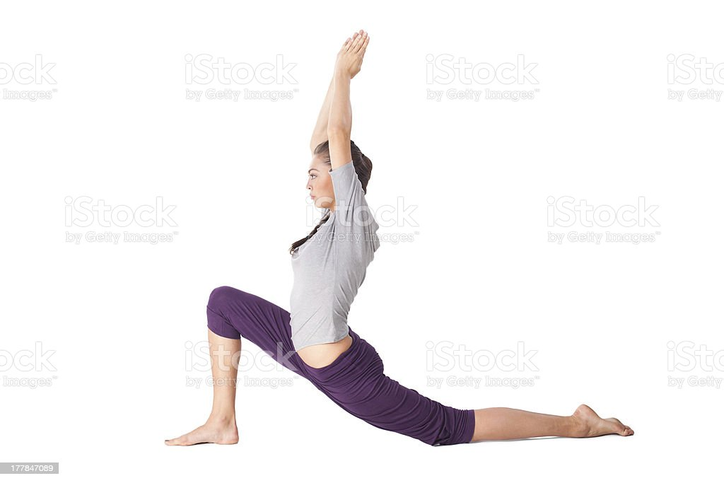 Young woman doing yoga exercise low lunge Anjaneyasana stock photo