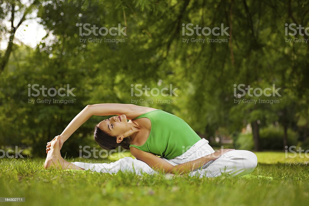 Young woman doing yoga exercise outdoor royalty-free stock photo