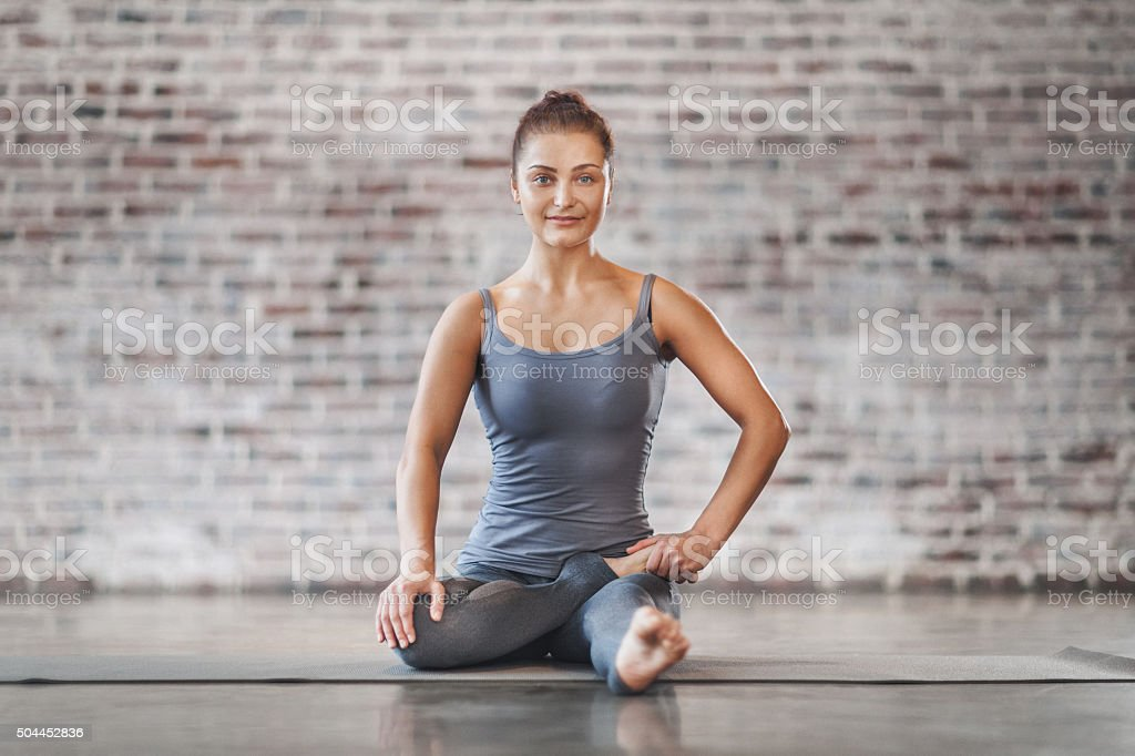 Young Woman Doing Yoga Exercise stock photo