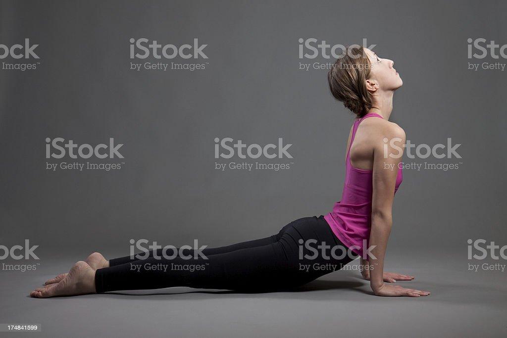 Young Woman Doing Yoga Exercises royalty-free stock photo