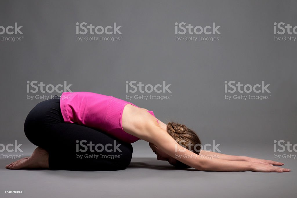 Young Woman Doing Yoga Exercises royalty-free stock photo