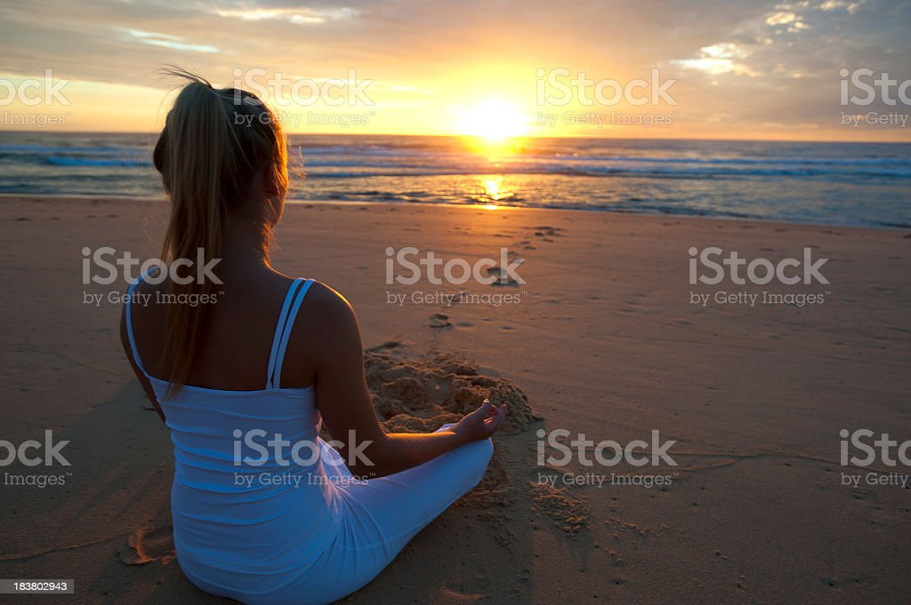 Young woman doing yoga in lotus position royalty-free stock photo