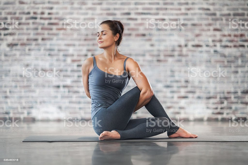 Young Woman Doing Yoga Meditation and Stretching Exercises stock photo