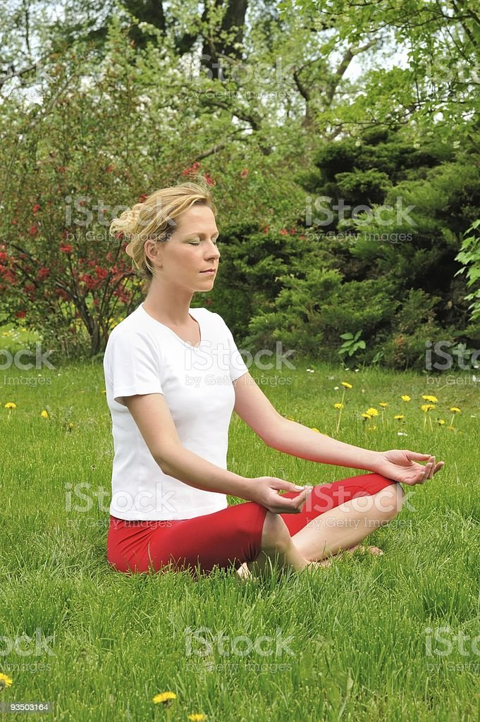Young woman doing yoga - meditation royalty-free stock photo