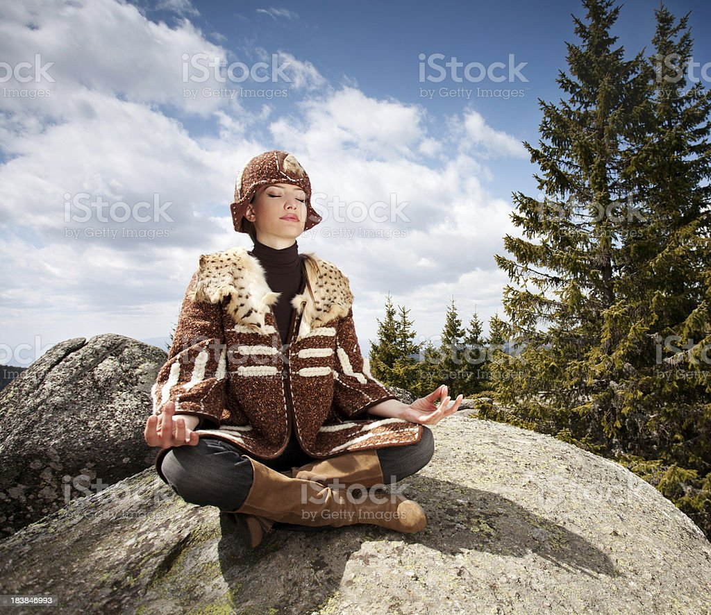 Young woman doing yoga on the mointain royalty-free stock photo