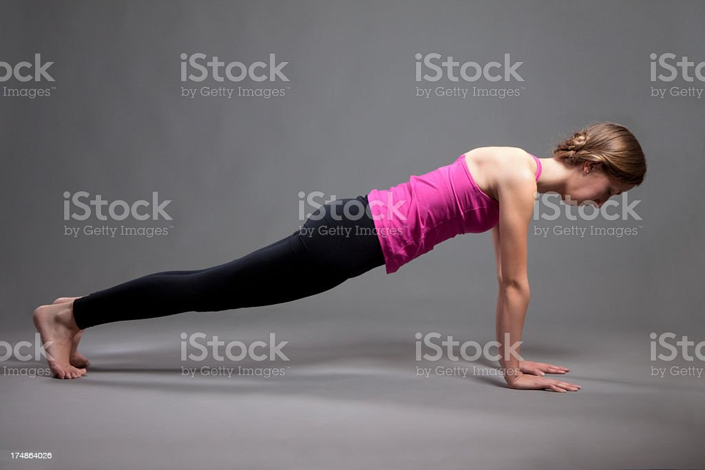 Young Woman Doing Yoga Plank Pose royalty-free stock photo